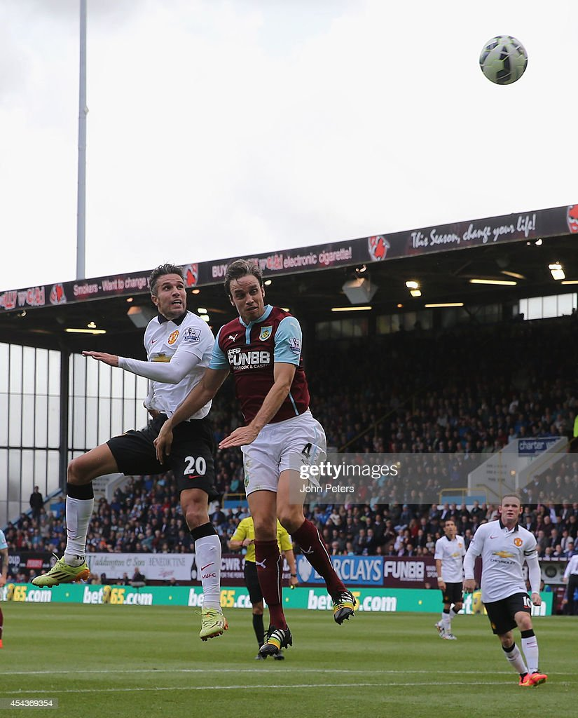Robin van Persie of Manchester United in action with Michael Duff of Burnley during the Barclays Premier League match between Burnley and Manchester United at Turf Moor on August 30, 2014 in Burnley, England.