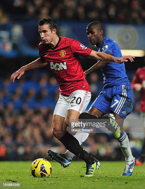 Robin van Persie of Manchester United is challenged by Ramires of Chelsea during the Barclays Premier League match between Chelsea and Manchester...