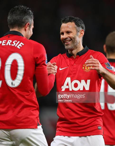 Robin van Persie of Manchester United is congratulated by Caretaker Manager Ryan Giggs after scoring his team's third goal during the Barclays...
