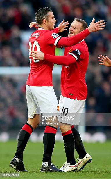 Robin van Persie of Manchester United is congratulated by teammate Wayne Rooney after scoring his team's first goal during the Barclays Premier...