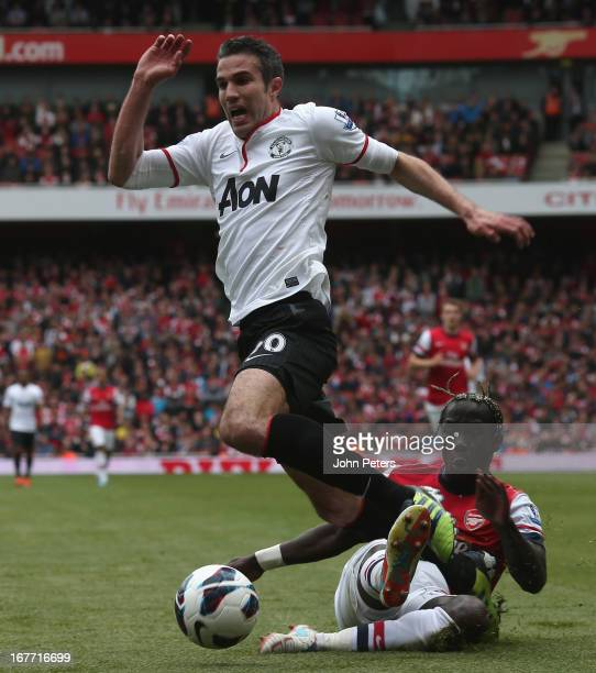 Robin van Persie of Manchester United is fouled by Bacary Sagna of Arsenal and is awarded a penalty during the Barclays Premier League match between...