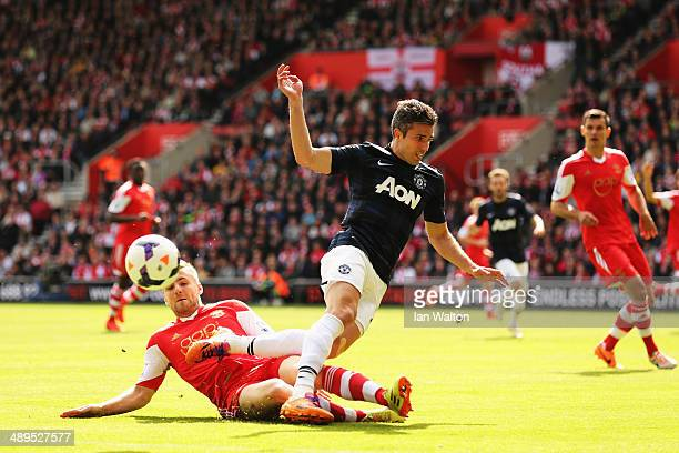 Robin van Persie of Manchester United is tackled by Luke Shaw of Southampton during the Barclays Premier League match between Southampton and...