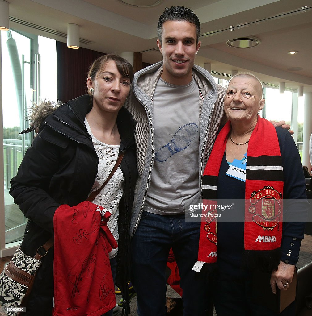 Robin van Persie of Manchester United meets Lorraine Miller (R) at a Manchester United Foundation Dream Day, for fans with life-limiting illnesses, at Aon Training Complex on October 28, 2013 in Manchester, England.