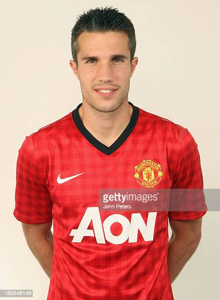 Robin van Persie of Manchester United poses in a Manchester United shirt after signing a four year contract with the club at Carrington Training...