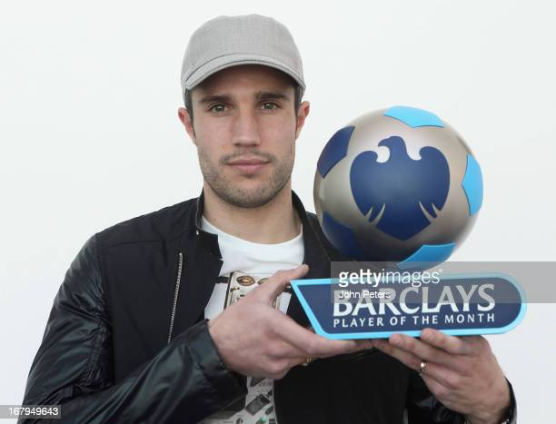 Robin van Persie of Manchester United poses with the Barclays Player of the Month award for April 2013 at Carrington Training Ground on May 3 2013 in...