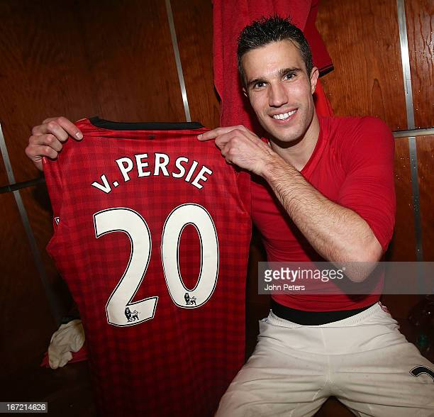 Robin van Persie of Manchester United poses with the number 20 shirt to denote 20 League titles won by Manchester United after the Barclays Premier...