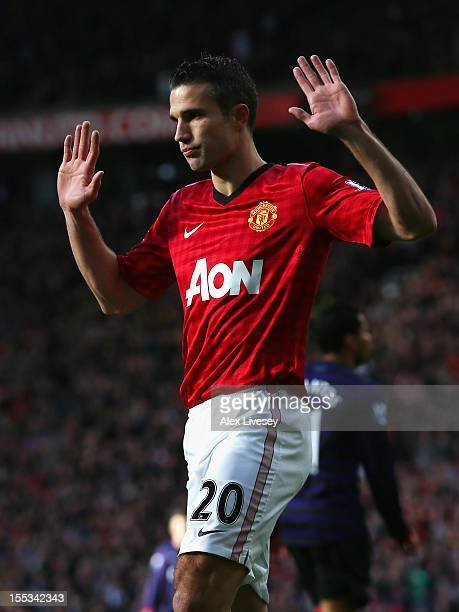 Robin van Persie of Manchester United reacts after scoring the opening goal during the Barclays Premier League match between Manchester United and...