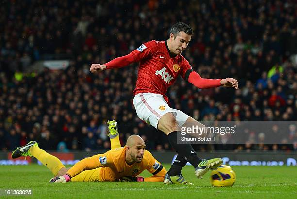 Robin van Persie of Manchester United scores his team's second goal during the Barclays Premier League match between Manchester United and Everton at...