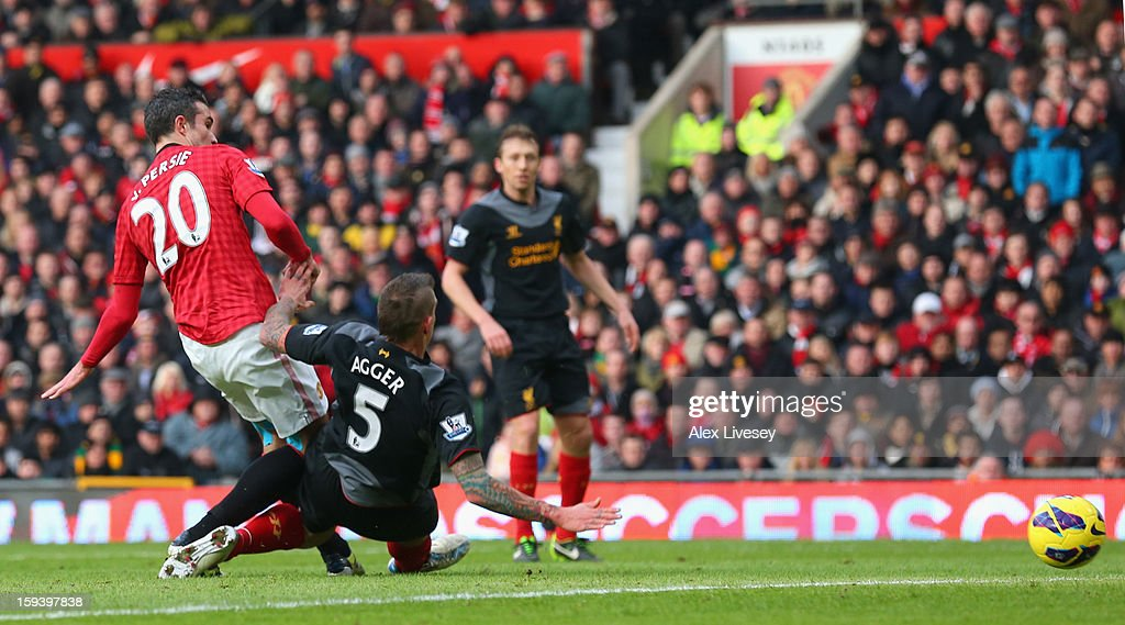 Robin van Persie of Manchester United scores the opening goal during the Barclays Premier League match between Manchester United and Liverpool at Old Trafford on January 13, 2013 in Manchester, England.