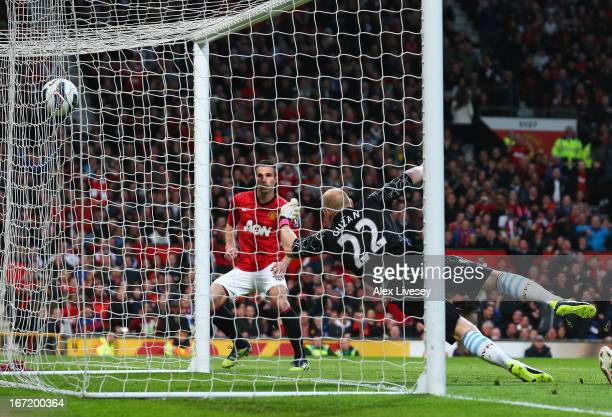 Robin van Persie of Manchester United scores the opening goal during the Barclays Premier League match between Manchester United and Aston Villa at...
