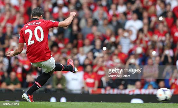 Robin van Persie of Manchester United scores their first goal during the Barclays Premier League match between Manchester United and Crystal Palace...