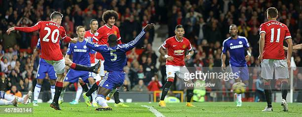 Robin van Persie of Manchester United scores their first goal during the Barclays Premier League match between Manchester United and Chelsea at Old...