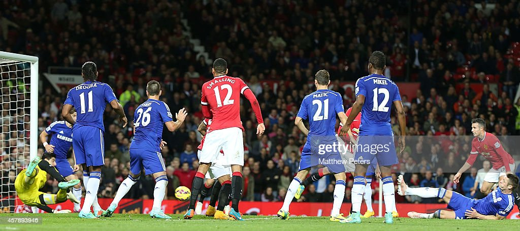 Robin van Persie of Manchester United scores their first goal during the Barclays Premier League match between Manchester United and Chelsea at Old Trafford on October 26, 2014 in Manchester, England.