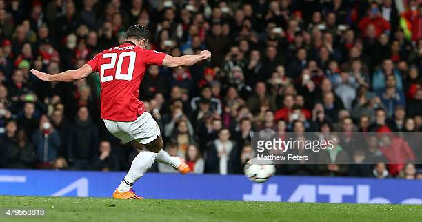 Robin van Persie of Manchester United scores their first goal during the UEFA Champions League Round of 16 second leg match between Manchester United...