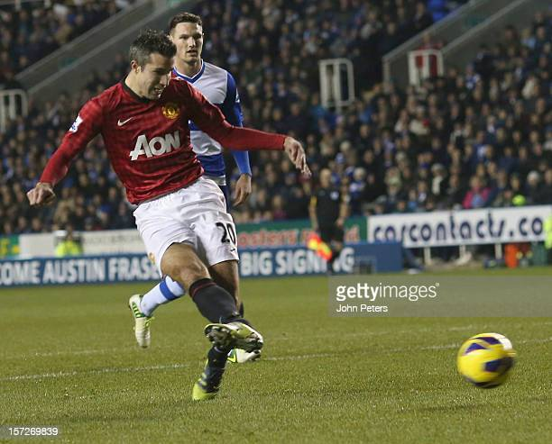 Robin van Persie of Manchester United scores their fourth goal during the Barclays Premier League match between Reading and Manchester United at...