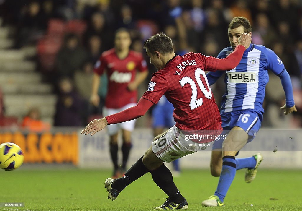 Robin van Persie of Manchester United scores their fourth goal during the Barclays Premier League match between Wigan Athletic and Manchester United at DW Stadium on January 1, 2013 in Wigan, England.