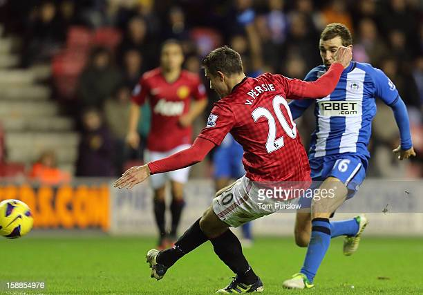 Robin van Persie of Manchester United scores their fourth goal during the Barclays Premier League match between Wigan Athletic and Manchester United...