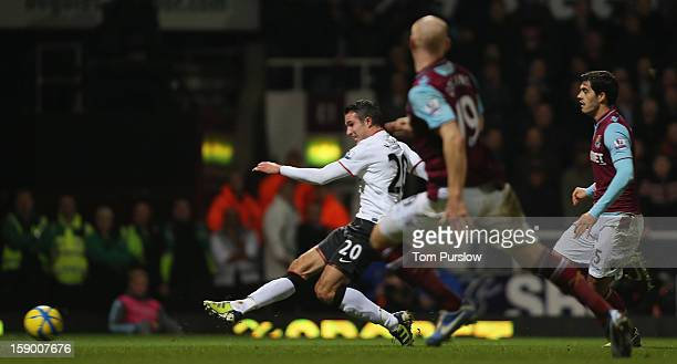 Robin van Persie of Manchester United scores their second goal during the FA Cup Third Round match between West Ham United and Manchester United at...
