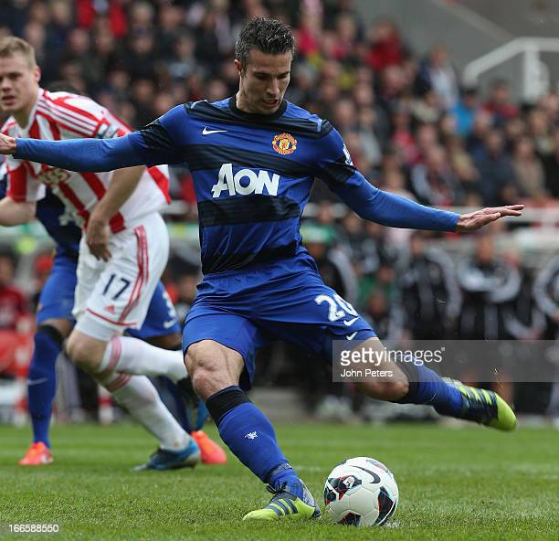 Robin van Persie of Manchester United scores their second goal n during the Barclays Premier League match between Stoke City and Manchester United at...