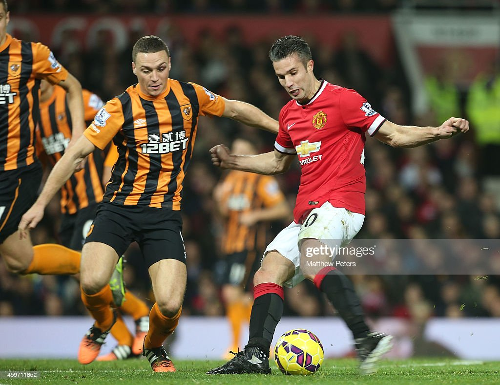 Robin van Persie of Manchester United scores their third goal during the Barclays Premier League match between Manchester United and Hull City at Old Trafford on November 29, 2014 in Manchester, England.