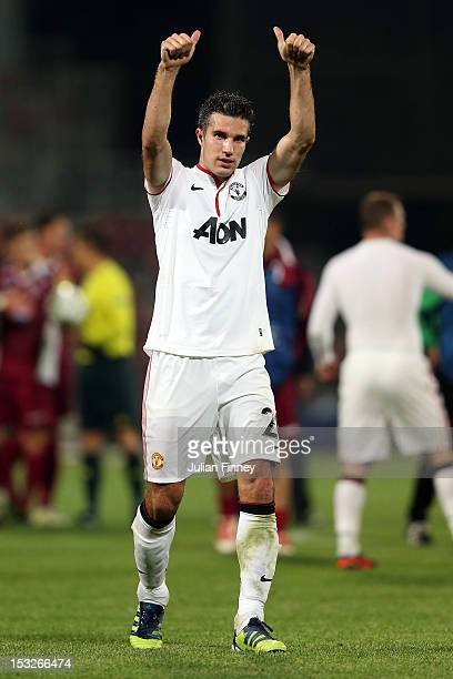 Robin van Persie of Manchester United thanks the support after the UEFA Champions League Group H match between CFR 1907 Cluj and Manchester United at...