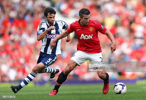 Robin Van Persie of Manchester United turns away from Claudio Yacob of West Bromwich Albion during the Barclays Premier League match between...