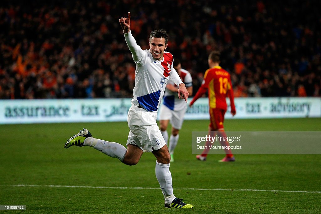 Robin Van Persie (#9) of Netherlands celebrates after scoring the second goal of the game during the the Group 4 FIFA 2014 World Cup Qualifier match between Netherlands and Romania at Amsterdam Arena on March 26, 2013 in Amsterdam, Netherlands.