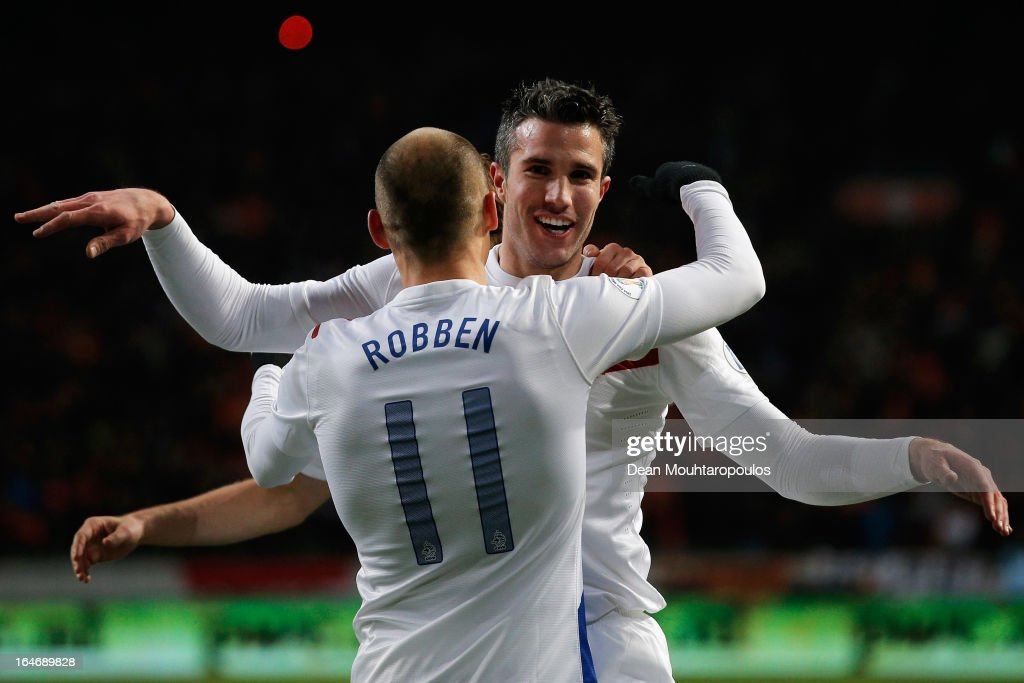 Robin Van Persie (#9) of Netherlands celebrates with team mate Arjen Robben after scoring the second goal of the game during the the Group 4 FIFA 2014 World Cup Qualifier match between Netherlands and Romania at Amsterdam Arena on March 26, 2013 in Amsterdam, Netherlands.
