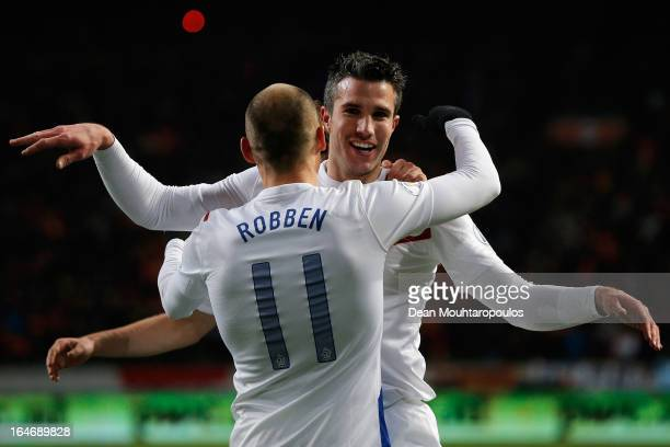 Robin Van Persie of Netherlands celebrates with team mate Arjen Robben after scoring the second goal of the game during the the Group 4 FIFA 2014...