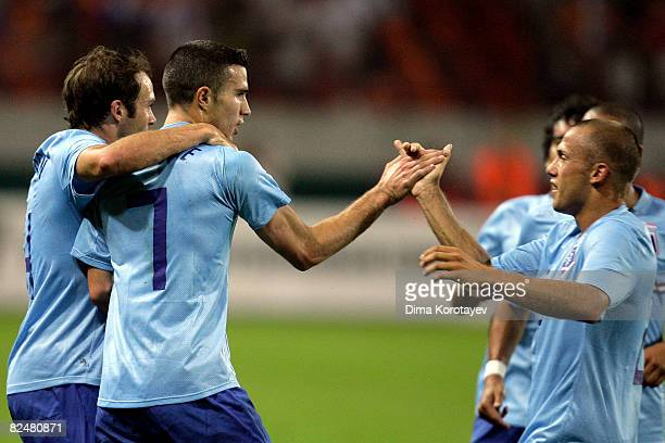 Robin van Persie of Netherlands celebrates with teammates after scoring during the friendly international soccer match between Russia and Netherlands...