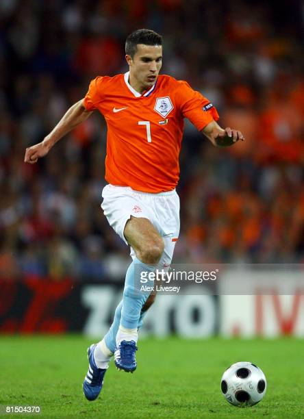 Robin van Persie of Netherlands runs with the ball during the Euro 2008 Group C match between Netherlands and Italy at Stade de Suisse Wankdorf on...