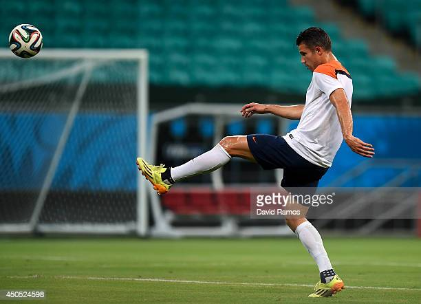 Robin Van Persie of Netherlands shoots towards goal during the Netherlands training session before the 2014 FIFA Word Cup Group B match between Spain...