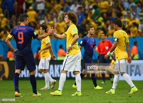 Robin van Persie of the Netherlands and David Luiz of Brazil greet each other after a 30 Netherlands victory during the 2014 FIFA World Cup Brazil...