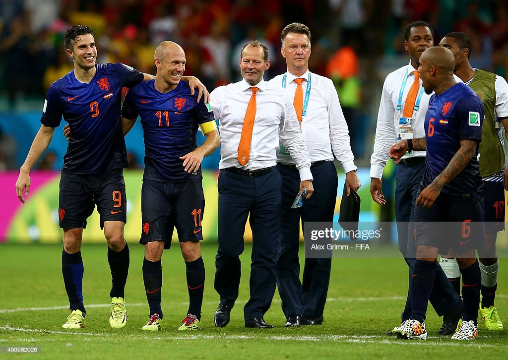 Robin van Persie of the Netherlands (L), Arjen Robben of the Netherlands (2nd L) and Louis van Gaal of the Netherlands (C) of the Netherlands celebrate after the 2014 FIFA World Cup Brazil Group B match between Spain and Netherlands at Arena Fonte Nova on June 13, 2014 in Salvador, Brazil.