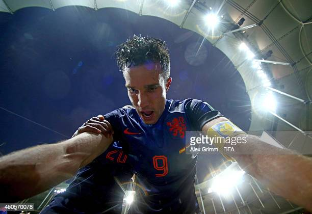 Robin van Persie of the Netherlands celebrates after scoring a goal during the 2014 FIFA World Cup Brazil Group B match between Spain and Netherlands...
