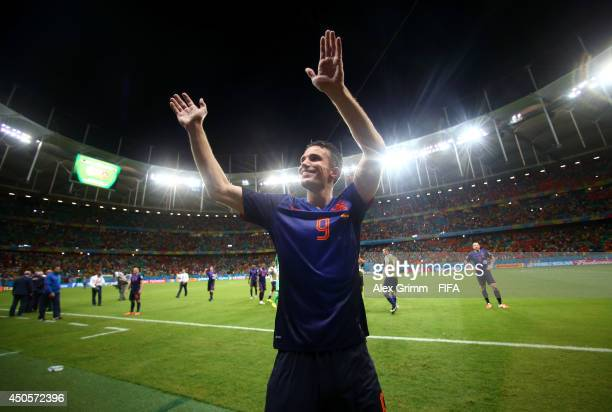 Robin van Persie of the Netherlands celebrates following the 2014 FIFA World Cup Brazil Group B match between Spain and Netherlands at Arena Fonte...