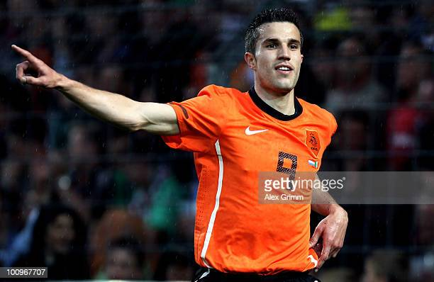 Robin van Persie of the Netherlands celebrates his team's first goal during the international friendly match between the Netherlands and Mexico at...