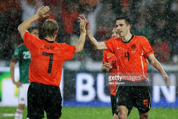 Robin van Persie of the Netherlands celebrates his team's second goal with team mate Dirk Kuyt during the international friendly match between the...