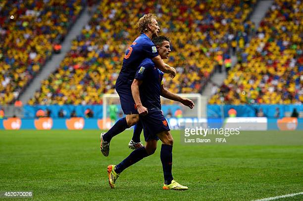 Robin van Persie of the Netherlands celebrates scoring his team's first goal with his teammate Dirk Kuyt during the 2014 FIFA World Cup Brazil 3rd...