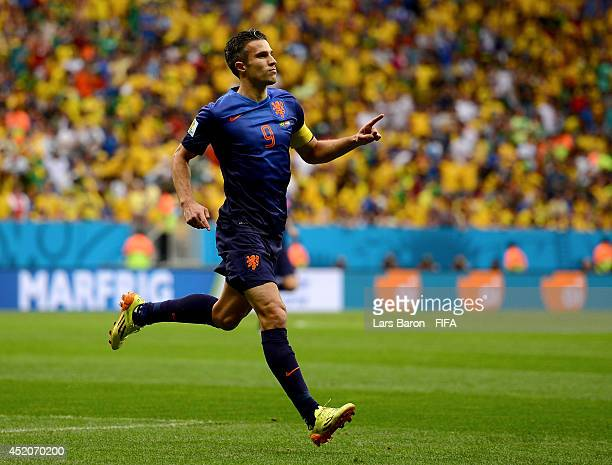 Robin van Persie of the Netherlands celebrates scoring his team's first goal from the penalty spot during the 2014 FIFA World Cup Brazil 3rd Place...