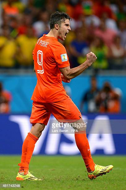Robin van Persie of the Netherlands celebrates scoring in the penalty shootout during the 2014 FIFA World Cup Brazil Quarter Final match between...