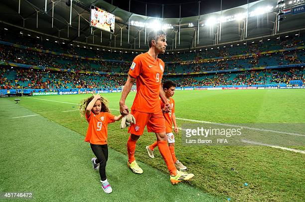 Robin van Persie of the Netherlands celebrates the win with his daughter Dina Layla and son Shaqueel after the 2014 FIFA World Cup Brazil Quarter...