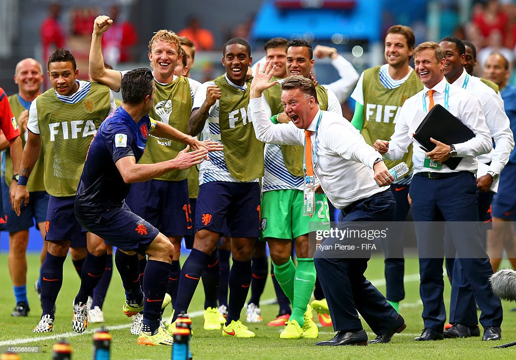 Robin van Persie of the Netherlands (C-L) celebrates with coach Louis van Gaal of the Netherlands (C-R) and team-mates after scoring a goal during the 2014 FIFA World Cup Brazil Group B match between Spain and Netherlands at Arena Fonte Nova on June 13, 2014 in Salvador, Brazil.