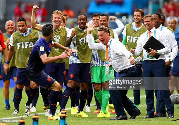 Robin van Persie of the Netherlands celebrates with coach Louis van Gaal of the Netherlands and teammates after scoring a goal during the 2014 FIFA...