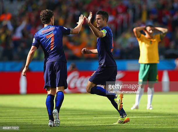 Robin van Persie of the Netherlands celebrates with Daryl Janmaat after scoring the second goal during the 2014 FIFA World Cup Brazil Group B match...