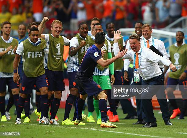 Robin van Persie of the Netherlands celebrates with head coach Louis van Gaal of the Netherlands after scoring the team's first goal in the first...