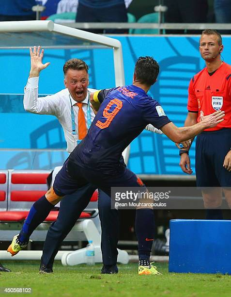 Robin van Persie of the Netherlands celebrates with head coach Louis van Gaal after scoring the team's first goal in the first half during the 2014...