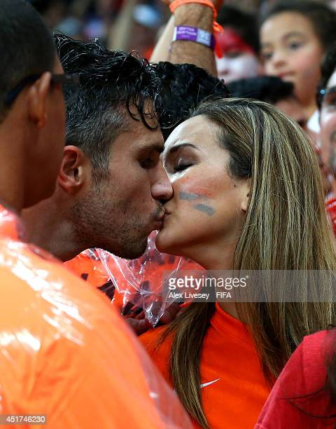 Robin van Persie of the Netherlands kisses his wife Bouchra after the win in the 2014 FIFA World Cup Brazil Quarter Final match between Netherlands...