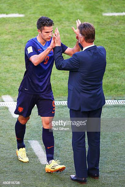 Robin van Persie of the Netherlands reacts with head coach Louis van Gaal as he exits the game during the 2014 FIFA World Cup Brazil Group B match...