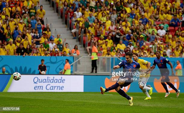 Robin van Persie of the Netherlands scores his team's first goal from the penalty spot during the 2014 FIFA World Cup Brazil 3rd Place Playoff match...